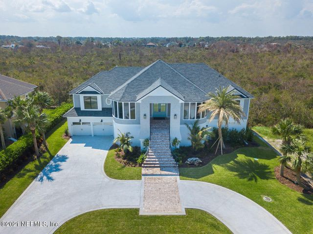 See the sunrise over the ocean from your front windows and watch gorgeous sunsets over the nature preserve off the back balcony. This coastal beach chic home on Ponte Vedra Blvd with deeded beach access is spacious, bright and well-appointed. The home was taken to the studs, reconfigured and expanded under the guidance of award-winning architect Nick Renard in 2017. Notable features: hickory flooring, modern steel stair railings, quartzite countertops, coffered ceilings, and pecky cypress wall and ceiling treatments. The master suite, with luxury bath and dream closet is upstairs, as is another bedroom and bath. Downstairs has 3 spacious bedroom/baths, as well as a media/gathering room. Elevator for easy access. Storage galore.