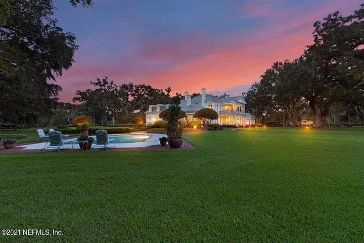 All the luxury you deserve... Welcome to one of Jacksonville's most incredible homes.  Approximately 15 acres along The St Johns River offering 600 feet of river frontage. A rare find for a residential property in Jacksonville. As you drive through the gated entrance the extraordinary landscape and manicured lawn gives the feeling of a private park. A dock for yacht mooring, fishing & sunset gazing or relax and lounge by the pool. This architectural masterpiece was designed by famous Architect, Barry Fox who was known for blending gracious charms and classical proportions of older eras. Entertaining small or large groups there is an abundance of parking. A wing of the home designed especially for guest with 3 bedrooms and a gathering room. The master bedroom offers captivating views located on the second floor opening out to an extraordinary balcony. The home is expansive and manorial with quoins and pillars fabricated from Indiana limestone and a veneer of hand molded brick painted a creamy white. East facing, the front of home has the look of a Georgian plantation. The rear elevation overlooking the river is more East-Indian-Georgian in appearance. The ancient live oaks draping the property are the backdrop.  Also on the property is an outbuilding which includes a caretaker's office & 3 car garage along with a two bedroom apartment upstairs...
