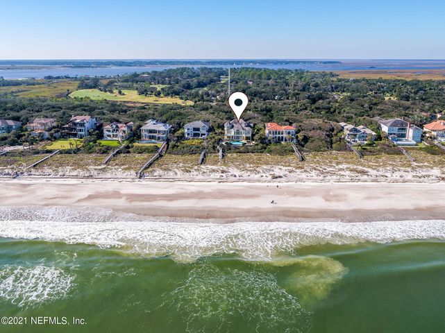 This sprawling ocean front mansion is situated on over one acre within the gates of The Sanctuary, a private and exclusive community located on the southernmost tip of Amelia Island. The sound of the ocean beckons and the sweeping views draw you in as you enter through the natural stone archway to the grand rotunda featuring custom inlaid marble tile. This spacious 8,755 SQ FT masterpiece offers 5 beds, 6.5 baths, 3 fireplaces, and multiple balconies overlooking the Atlantic Ocean. Like none other, this hallmark Brylen Home features unparalleled details and resort luxuries such as an infinity edge pool and spa, marble showers, cherry encased media room, 3rd floor observation tower, guest wing with private sitting room and wet bar, and a custom wine cellar. Rich stone accents, intricate woodwork, and picturesque views throughout the Palladian windows, this home is truly a sanctuary complete with its very own private boardwalk to the beach. Private club memberships,golf, and spas nearby.