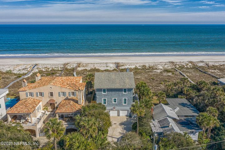 Welcome to this 3-story oceanfront oasis with expansive water views in the coveted community of Atlantic Beach. Walk out onto the balcony to see stunning sunrises, and watch dolphin pods swim by. This custom-built Masonry & Cedar Shake home with soaring 10ft. ceilings, oversized windows, elevator, wine cellar and pool offers exclusive beach lifestyle. The moment you step through the front door of the main level and into the living room the view will take your breath away. This bright airy room has tall windows, a wood burning fireplace with tile face & mantle. Opposite the LR is a traditional dining room with plantation shutters, wainscoting, custom cabinetry, butlers & walk-in pantry, powder room, study & laundry room. This level also features an open plan concept with Gourmet Kitchen (2015), SubzeroTM refrigerator/freezer, double oven, induction stove top, quartz countertops, Bosch dishwasher, generous eating area, and family room with built-in bookshelves. Wood flooring throughout. On the 3rd floor you'll find a spacious Owners suite with vaulted ceiling, French doors to a 30' balcony, his and hers walk in closets, owner's bath, double sinks, walk-in shower, garden tub, water closet and bidet. 2 large BR's with bay window seats and full bath. The 1st floor is a complete package for entertaining guests. A walk-in wine cellar includes shelving to store 1500 bottles of wine, a private 4th bedroom/guest ensuite, walk-in closet, french doors. den, cabana/kitchenette, & 1.5 baths. French doors lead to a sparkling pool surrounded by a large deck perfect for family gatherings and sunbathing. Outdoor private shower, a 3car garage & add'l parking for 8 cars. Meander down the private boardwalk past the natural dunes to the white sandy beach below. Toss a paddle board into the water and your off on an adventure. At dusk watch the baby sea turtles hatch, making their journey to the sea. Don't miss this spectacular must see home!