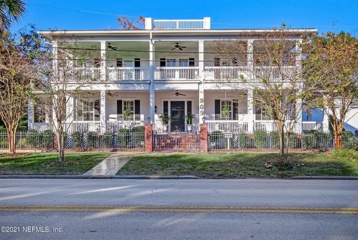 Timeless elegance meets modern comfort in one of Fernandina Beach's most beautiful properties! Sitting on a double, corner lot in Historic District, this stately mansion, built 2014, is perfectly situated between the Intracoastal Waterway and Atlantic Ocean. Walk west to restaurants, shops and sunsets, or east , to beach for sunrises. Enjoy parades, fireworks and Shrimp Festival from expansive porches. The Master on main floor has his/her baths and closets. 4 more bedrooms have full en suite baths. There are three 1/2 baths, one on each floor. There's a Rec Room, library, study, play room, family room, formal areas, 2 kitchens, butler's pantry, bar, heated pool, pool bath, outdoor kitchen, bunk room, mud room, keeping room, two laundry rooms, elevator, 3 car garage!