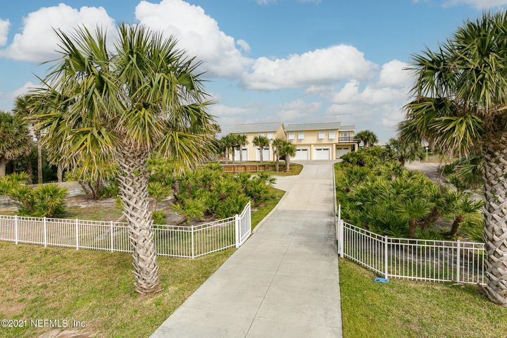 As soon as you walk in either house all you see is ocean from your super high dune. . The Boardwalk to the white, wide beautiful Crescent Beach is a vacation everyday! Your view is 100 feet of ocean that you enjoy from the large back deck, living room and kitchens . The Intracoastal views from all 4 bedrooms is a priceless bonus! You can just walk into paradise because everything has been done for you. Totally renovated main house and the newly constructed guest house has everything. Main Home has 2 bedrooms 2 full baths and the Guest House also has 2 bedrooms and 2 baths---and the wow 4 car garage factor! Looking to walk to work-the Guest house is a step away for your private office and Guest suite, In-laws visiting or permanent and Kids moving home. Stay in one, rent the other...choices are endless. This Oceanside Compound has a list of upgrades that include; all plumbing and electrical replaced in main house, underground utilities added, city sewer, new driveway, two new AC's, new appliances , complete with hurricane curtains and Bahama Shutters and more! Plus Rv or Boat Parking with electricity that does not take away from the motor court. Don't miss your chance to live in paradise!