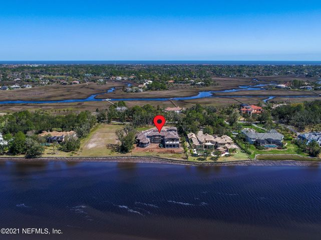 Magnificent Tuscan inspired Estate home under construction in Marsh Landing in the exclusive Harbour Island Estates w/ Intracoastal Views.  Incredible location and estate sits on over 1.7 acres with expansive Intracoastal frontage.  60' boat slip included in main yacht basin (#623) and just a short golf cart ride away. This is truly a one-of-a-kind; designed by well renowned Weber Design Group from Naples FL. The concept of the design was to provide the homeowners w/ the utmost privacy while offering plenty of indoor and outdoor spaces. Over 14,000 sq ft of conditioned space with 18,520 under roof.  This Estate has everything: Guest Suite w Kitchenette, Home Theatre, Man Cave, Kids Play & study areas, Upstairs Spa & Yoga room, two master suites & incredible Intracoastal views. The beautiful sprawling estate features many more unique features and living spaces offering the homeowners and their family ultimate comfort in the lap of luxury.  All on over 1.7 acres with direct Intracoastal Views & a 60' boat slip in the nearby Yacht Basin. FULL GOLF INITIATION INCLUDED TO MARSH LANDING COUNTRY CLUB.