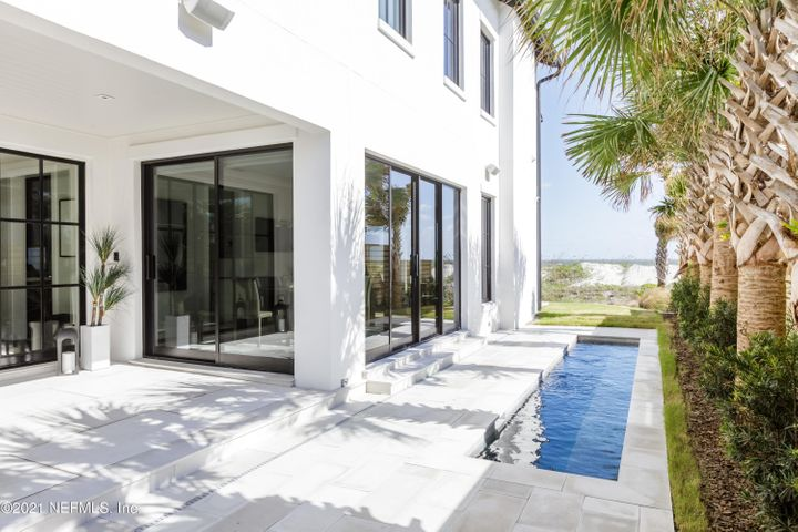 Location, location, location!! This is a rare opportunity to own a brand new smart home on the ocean!! This 3 story luxurious home features beach views throughout! Accessible with a stunning glass elevator. This home offers an open floor plan downstairs with a guest bedroom and laundry room.  On the second floor there is an office space, laundry room and three bedrooms, including the stunning master ensuite overlooking the ocean with a large balcony. The third floor is the most dreamy entertainment room with a wet bar and projector screen! This home has easy access to the Ponte Vedra Inn & Club, JTB and many shops, restaurants and grocery stores.This is the ideal location at the beach! Completely furnished, this home is ready for its new owner
