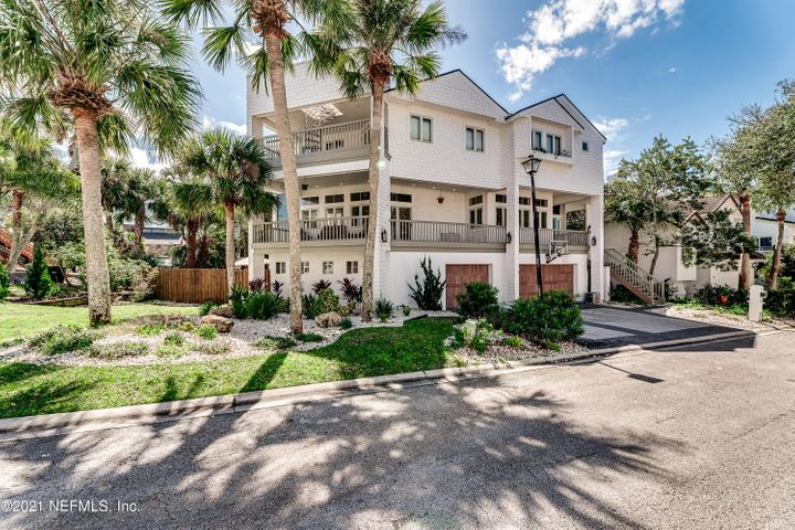 This contemporary home has the perfect blend of indoor and outdoor living spaces. Enjoy ocean views from your third level owner's suite and access to your rooftop deck via the spiral staircase. This unique tri-level plan offers 4 bedrooms and 5.5 baths with expansive living areas making this a perfect home for entertaining. Situated on a double lot which features a fully fenced yard area. A rare opportunity to own in this small exclusive beach side community.