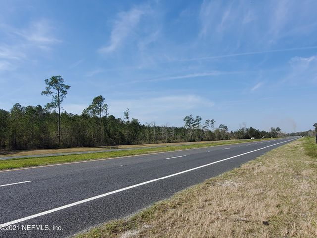 PRIME INVESTMENT Opportunity in up and coming Yulee, FL. Parcels combined have 1 1/2 Miles of Road Frontage on State Road 200. South Parcel sits Adjacent to the New ''Tributary'' Neighborhood by Three Rivers. Both Parcels are located close to the Interstate and the New Wild-light Development with all the New Businesses, Restaurants, Office Space, Homes, Town homes and Apartments, as well as a New School and Hospitals. Now is the time to invest or join in the New Development in Nassau County. (Ranked 2nd fastest growing County in Florida).
