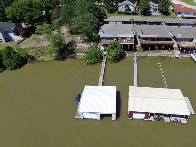 Your lake home with enclosed 2 slip dock. Boat lifts and jet ski port negotiable.