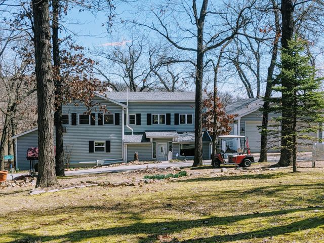 This lake cabin sits on a gorgeous 1 acre lot with mature trees.