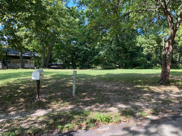 Mostly cleared with level lot for home sites.