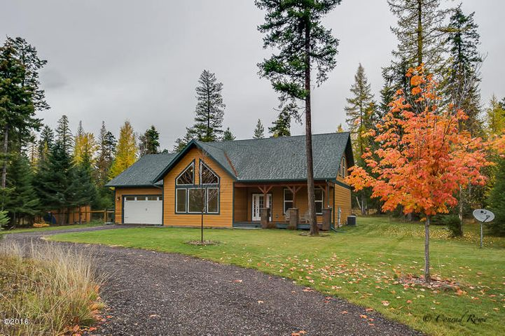 Custom 2,352 sf., 3bed/2bath home on private double wooded 1.48 acre lot, large circular driveway, community access to Swan Lake, minutes to Bigfork and Flathead Lake!