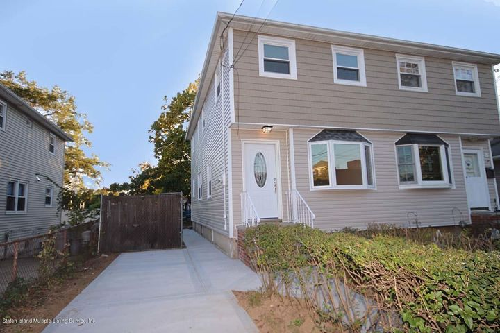 Brand New Siding throughout the home, All Windows are new, and a 2 car driveway(can be extended to fit even more!
