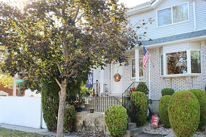 LOCATION! ABOVE AMBOY ROAD. Colonial, 3 Bedrooms, Living Room, Dining Room, Eat in Kitchen, 2 Baths, Yard, Private Driveway PLUS Finished Basement with Side Entrance.