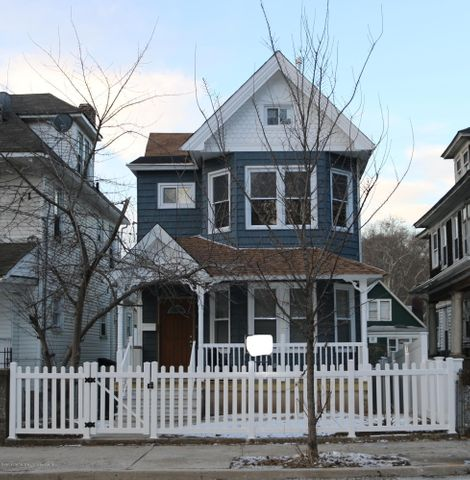 step inside the white picket fence and welcome home! just steps away from the ferry! new siding and roofing!