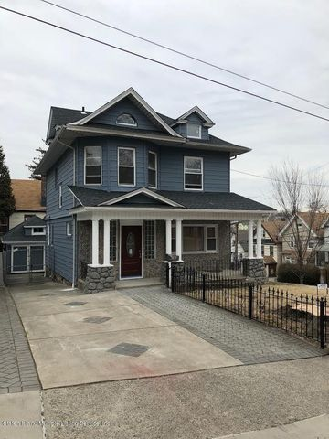 Gorgeous victorian home with large driveway and detached garage