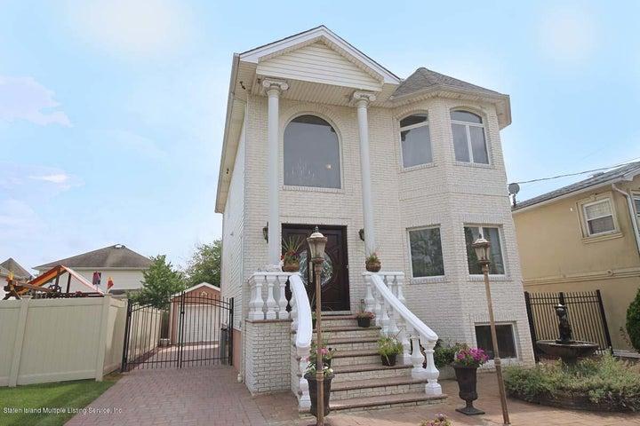 Note: custom marble chip brick front + granite steps & railings