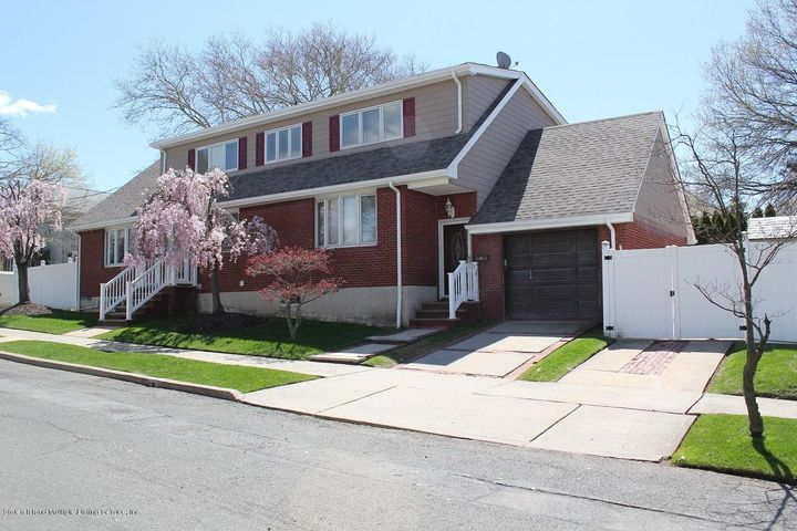 View of home showing garage and double driveway