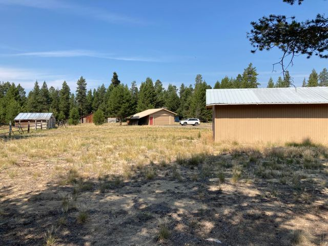 2.5 acres with two garages, a storage shed and fenced pasture.