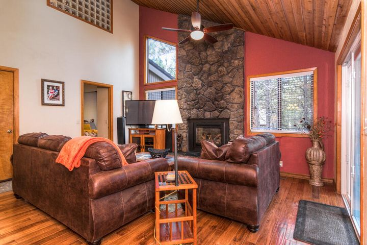 High, wood ceilings give #17 Coyote Lane in Sunriver an open, airy feel. There is a bedroom and a bath on the main floor with two more bedrooms and another bath upstairs.