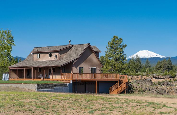 Come home to watch the sun set behind the full panoramic Cascade Mountain views! This beautiful, mountain modern, custom home was built to capture all the best of Central Oregon. Located only 4 miles to the Old Mill and set on 9.47 acres, this is the perfect close-in retreat. Enjoy the room of country living while being only minutes to the heart of Bend. Fill the shop with all your toys, and still have room for your boat and RV, with hookups already in place. If you're looking for a long term investment, this awesome property is situated right on the edge of the Urban Growth Boundary. Looking to self sustain on your own micro-farm? This property is ready for your vision! Come see it today!