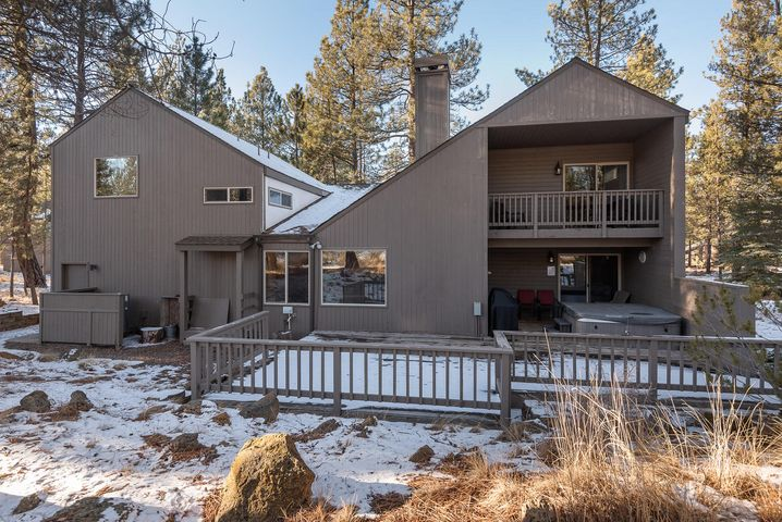 Spacious Sunriver home has it all. Fantastic location just down the street from the Sharc. Home features upgraded kitchen large cozy living room with woodstove, master suite with soaking tub, upgraded counters and walk-in closet. Upper and lower decks overlooking the forest and a loft that when custom Barn door closes turns into a second private master suite. Wood paneling throughout the home, Hot tub. This home would make a fantastic rental, residence or family get away. Home comes fully stocked and furnished, right down to kitchen items linens and 10 Sharc passes paid for 2021. Move in Ready!