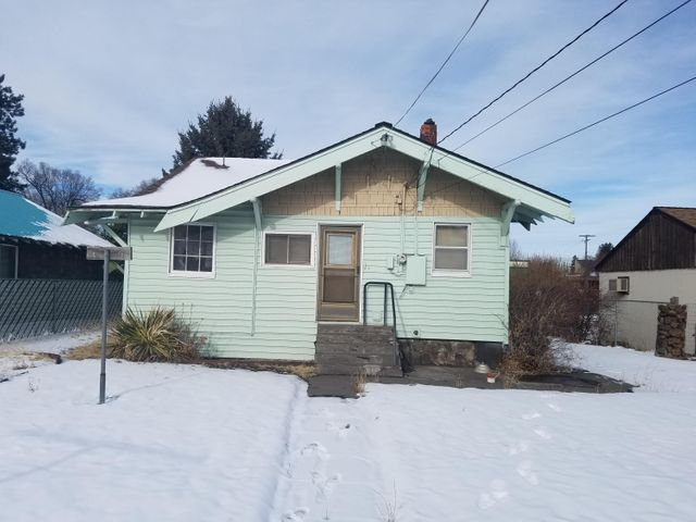 Well maintained home with many possibilities. Commercial zoning allows for a variety of uses. Good visibility from 3rd St./Hwy. 97. Detached 2 car garage with alley access. 468 square foot unfinished basement. Fully fenced yard. Convenient location close to everything.