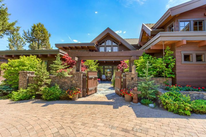 This custom built home was the vision of the owner who built high end custom homes throughout Central Oregon for years. The home features highlights of wood, stone and limestone features. The kitchen is a gourmet chefs dream. The large timbers magnificent windows and south facing exposure offer beautiful views of the 10th green of the Nicklaus golf course. There is a beautiful entry courtyard and casita. Water features surround the front and back yard. Thishome is special and has been recently repainted inside and wood floors redone. Price includes golf membership valued at 115,000.00.
