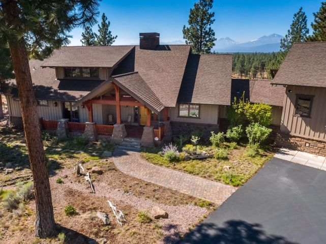 Few homes capture the essence of Central Oregon quite like this home. Your own private oasis awaits you on 18.79 acres of pristine land, scenic trails and serene high desert landscape. The minute you drive through the custom Peak-A-View gate, you will notice that no expense was spared on this stunning, custom-built home. Wake up to sunlit, snow covered panoramic views of the Cascade Mountains. Snuggle by the majestic floor-to-vaulted-ceiling wood burning fireplace featuring custom hand-cut saddle stones that were each hand placed by local masons. Chef's kitchen designed for both the home chef and entertainer alike and features Heartland appliances and Caesarstone counters. Working from home is a dream in the large home office with custom built-in bookshelves and private entry. A fully permitted and equipped one-bedroom cottage with its own entry sits above the heated 3-car garage. This legacy estate, in the greater Bend area, embraces true Central Oregon living.