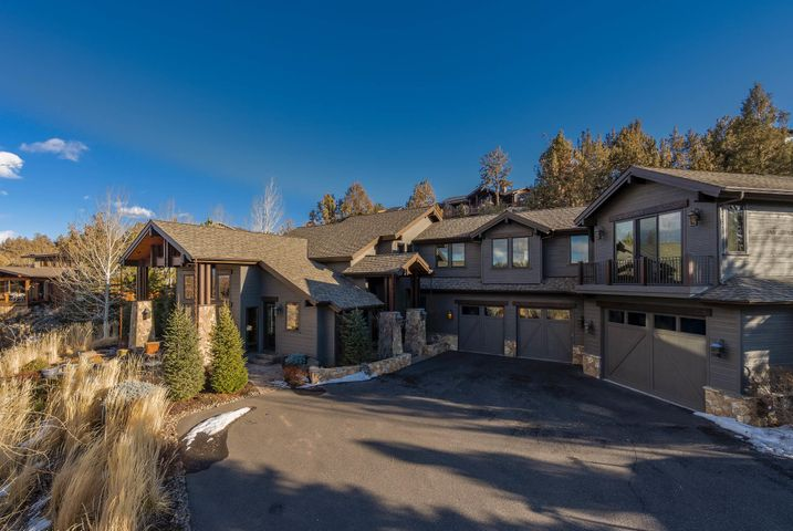Located within the exclusive Deschutes River Ranch, featuring Cascade Mountain views, nearly 2 miles of private Deschutes River access, swimming holes, waterfalls, fishing & acres of open space.  Truly special home combines a blend of contemporary & mountain home architecture. Well-considered floorplan encompasses inviting living areas, presenting superb design & an abundance of charm at every turn. Accentuated by floor to ceiling stone walls & exquisite wood accents that perfectly blend w/ the natural scenery.  Floor to ceiling windows in elegantly rustic great room frame the outstanding panoramas & flood interiors w/ sunlight. Well-equipped chef's kitchen flows into adjoining dining area. Owner's suite w/ cozy fireplace, balcony, steam shower & coffee bar. 3 guestrooms, office, home theater & billiard room.  1,760 sq.ft., 4-car garage. Outdoor living areas w/ outdoor kitchen, fireplace & hot-tub offer a seamless transition from the warm interiors to pastoral, mountain & river views.