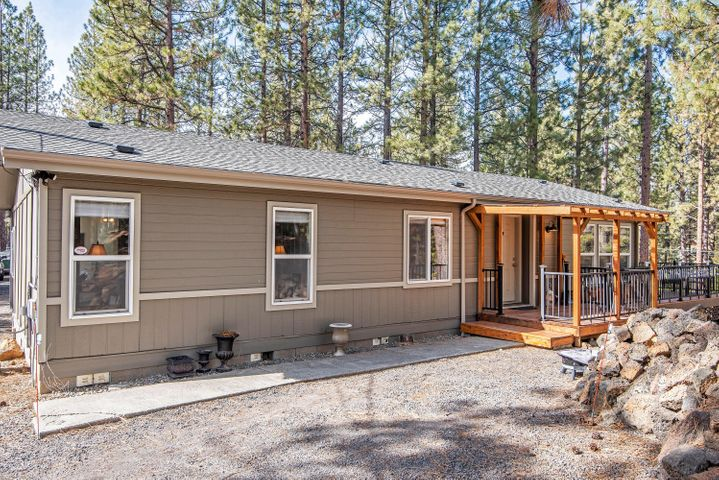 1995 manufactured home on large wooded lot in quieter section of Deschutes River Woods. Owners have updated many core systems within the last 2 years. Enjoy watching wild turkey, deer and squirrels from the new cedar surface wraparound deck. The deck has it's own pilings per code and attractive new metal railings and gates with build-in solar lights. New heated leaf guard gutters, roof and roof vents. Shared well has new pump and water filtration system with UV antibacterial light. Rock outcroppings and trees front and back add to private feel. RV parking and potential for a pull-through driveway. Nice size newer stick built shed affords plenty of storage. All appliances included - quiet running dishwasher, black stainless fridge, gas range and washer/dryer.