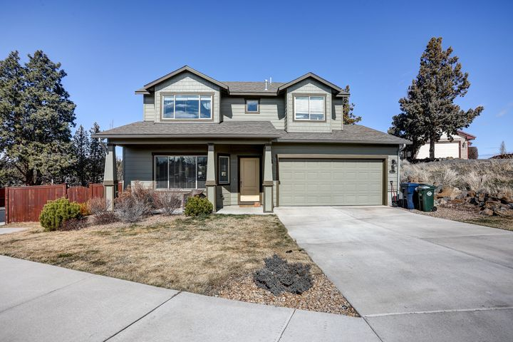 Light and bright home nestled on a corner lot in Bend's Northcrest neighborhood. Well cared for and conveniently located in NE Bend with easy access to neighborhood parks, schools, shopping and HWY 97. Fenced and landscaped yard, with nice deck ready for summer fun and BBQ's. Great room style floor plan with gas fireplace in the living area. Large island with tiled counters and stainless steel appliances. Large master with vaulted ceilings and double closets Natural Gas forced air heating and central A/C to keep cool on the hot summer days. This gem is sure to fly off the market in a hurry.