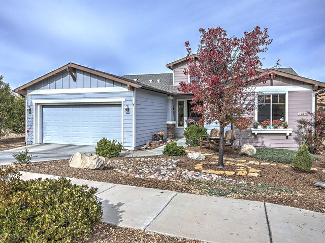 StoneRidge Lupine Home in Good Location with Mountain Views! Exterior with Siding & Stacked Rock Entry.