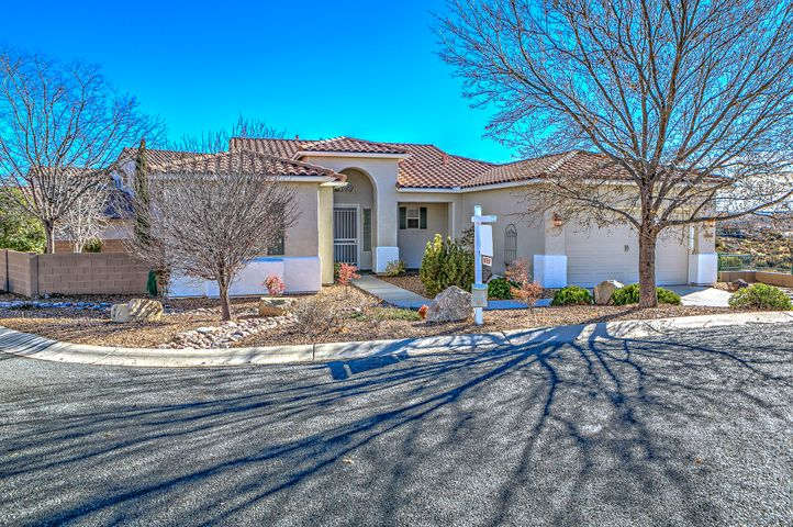 Great Cul-de-Sac Location w/ Views! Spanish Exterior with Cement Tiled Roof, Tall 8' Garage Door, Nice Pro-landscaping, Security Screen Door, Covered Front Porch & Large Wrap Around Rear Covered Patio with Travertine Floor Tile, Water Fountain Feature, Rear Yard Gas Fire Pit with Seating.