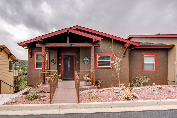 Welcome Home to this charming craftsman style house in a unique community-centered association.