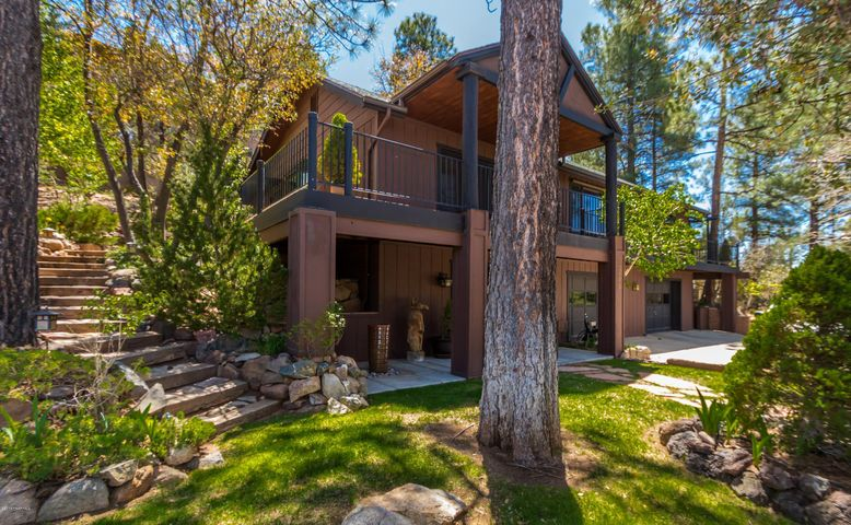 Nestled in the pines, come fall in love with this home!