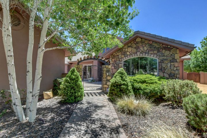 Great Curb Appeal with Gated Entry on both sides of Courtyard!