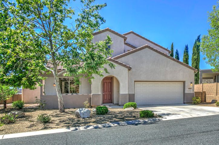 StoneRidge Granite Plan with Amazing Golf & Panoramic Mountain Views!! Front Stucco Exterior with Cement Tiled Roof, Mature Shade Trees & Covered Front Coffee Patio! Lets Relax Here!
