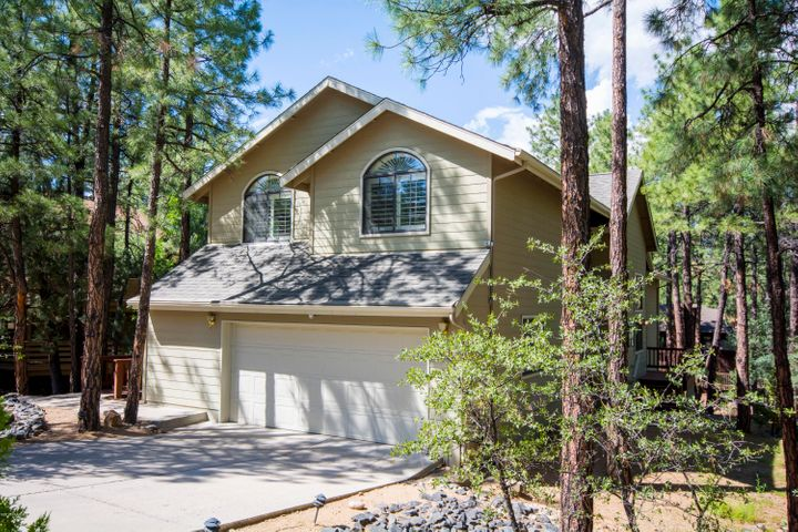 This meticulous Timber Ridge Home has it all!