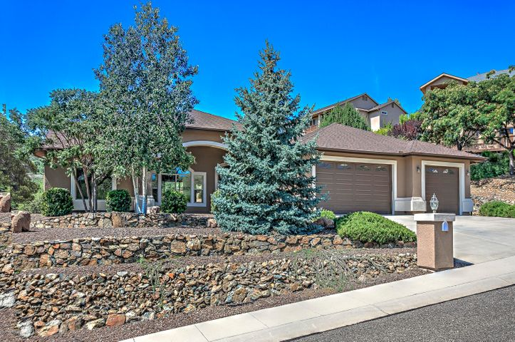 Brand New Exterior Paint, Beautiful Pro Landscaped Yards with Blue Spruce, Aspens, Tiered Rock & Drip Watering System.