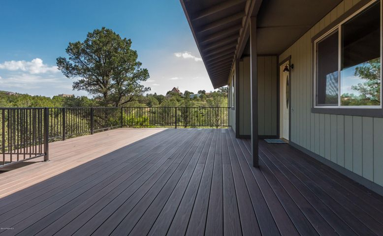 Huge level entry sundeck with easy maintenance decking & wrought iron handrailing