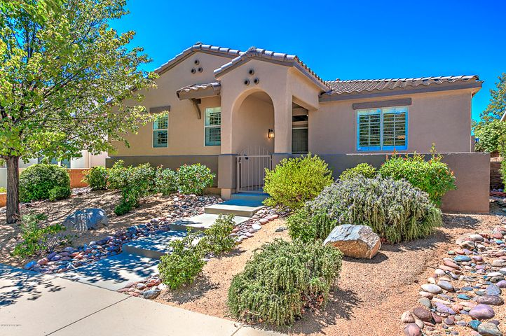 Completely Upgraded Highly Desired Spanish Monterra Plan with Concrete Roof & Open Front Porch Patio with Private Gated Entry.