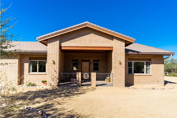 Ranch Style home with Western Design. 3 Bedroom ensuites plus half bath for guests.