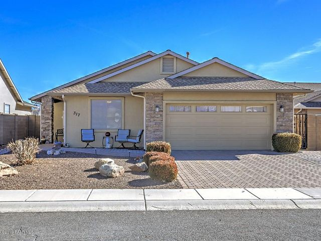 with Extra Wide Paver Driveway, Paver Open front Patio, Stacked Stone Accents, Sunscreens & Covered Front Porch with Security Screen Door.