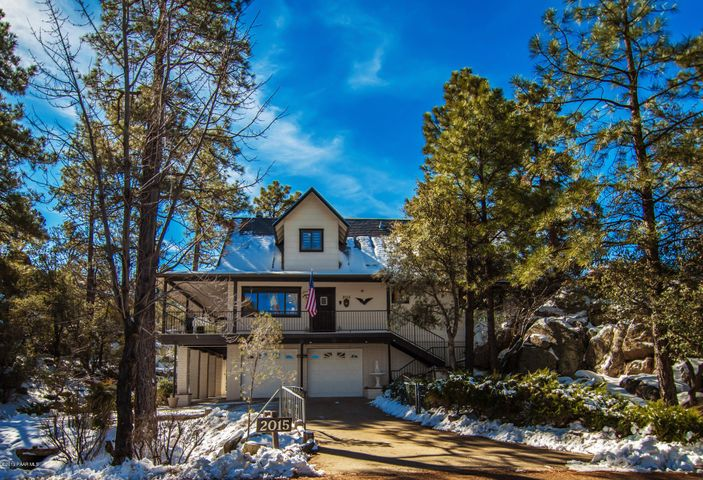 Tucked in the pines/boulders with a circular drive for easy access to 2 car garage or RV parking.