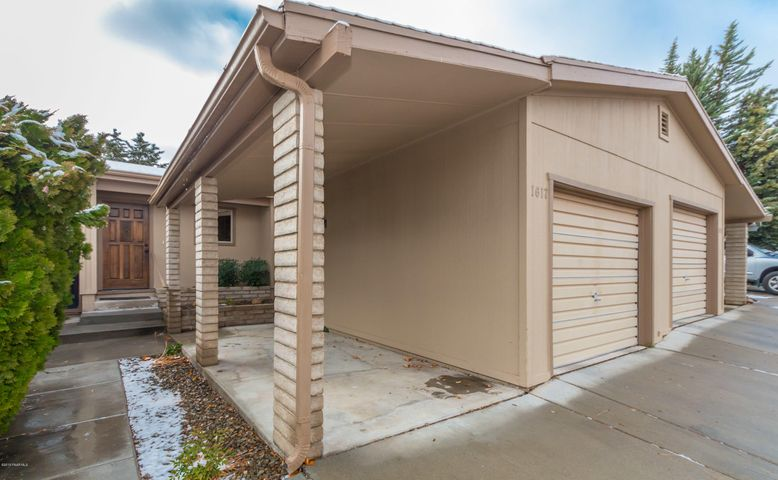 Front Exterior with 1 Car Garage and 1 Small Carport or Covered Patio