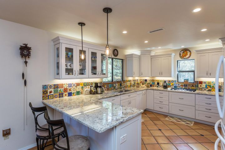 A sparkling new kitchen with all new appliances, granite countertops, and saltillo flooring. Home is updated throughou!