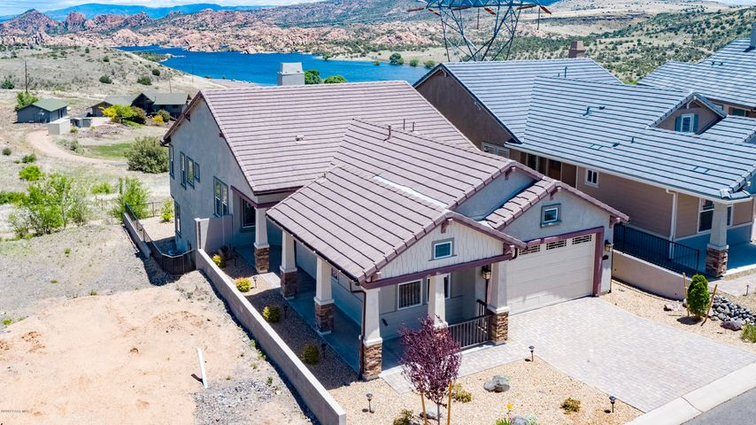 Aerial view - shows the lake and mountains behind the home.