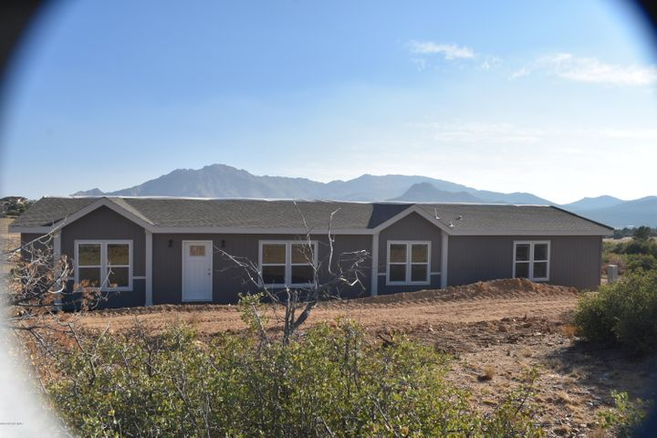 Front of home nestled on 2.27 acres in the heart of Williamson Valley,