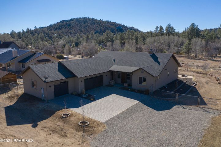 Custom Prescott home with 3 car garage, nestled in the hills.