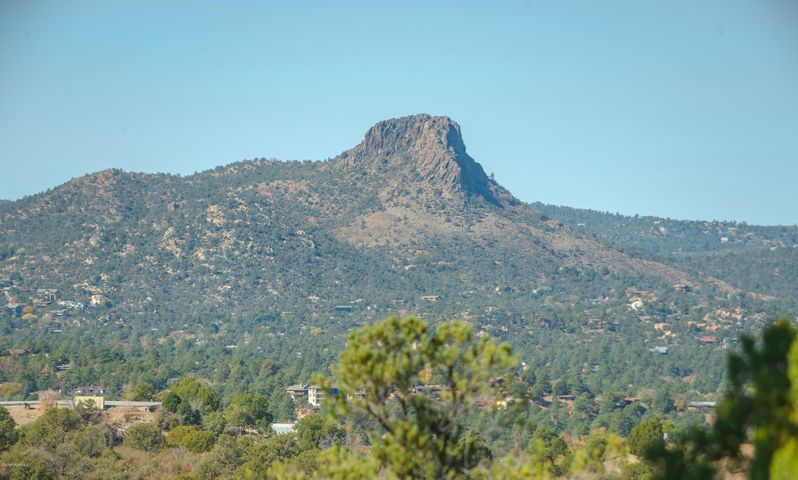 Unique lot less than 10 minutes from downtown! Nice upscale neighborhood in Prescott with private shared driveway. Beautiful views of Thumb Butte and the surrounding Bradshaw Mountain range. All city utilities available for this lot. Don't hesitate on this great lot. Swing by and check it out today!