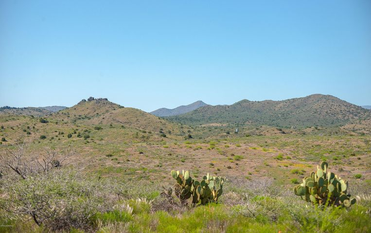 Great lot on a hill in the up and coming Bensch Ranch subdivision! Beautiful 360-degree panoramic views of the incredible mountain ranges and valleys of Yavapai county. Extremely quiet and gated community. Almost flat lot itching to have your next dream home built on. Swing by and check out this great deal or schedule a showing today!